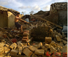 大塘村一村民从废墟中抢出建房用的木料